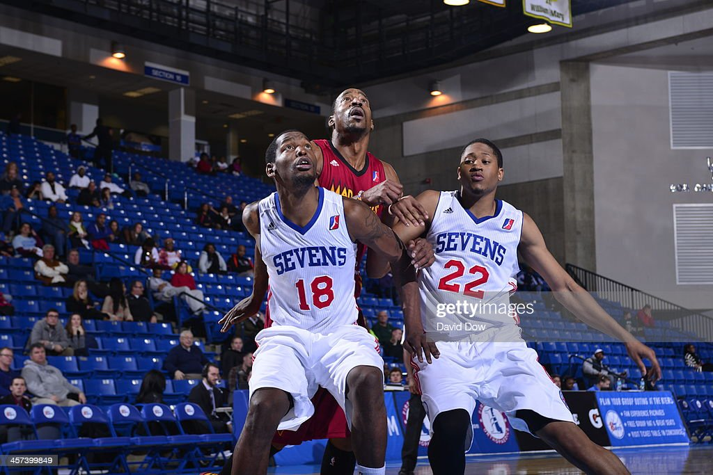 Damian Saunders and Rodney Williams of the Delaware 87ers fights for position against Chris Porter of the Fort Wayne Mad Ants during the NBA DLeague...