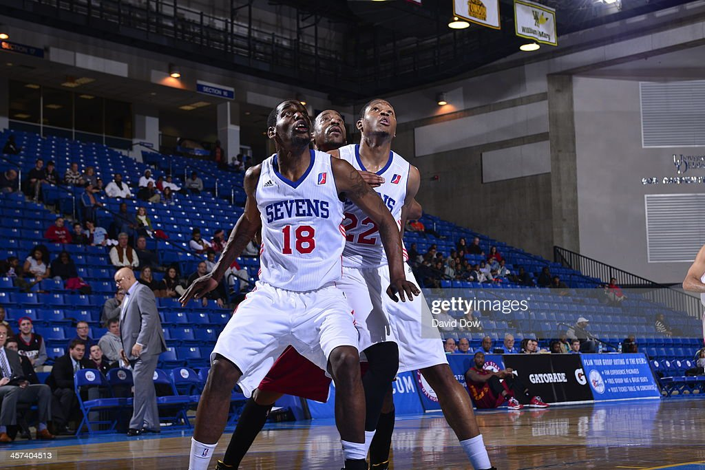 Damian Saunders of the Delaware 87ers fights for position against the Fort Wayne Mad Ants dribbles the ball against # of the Delaware 87ers during...