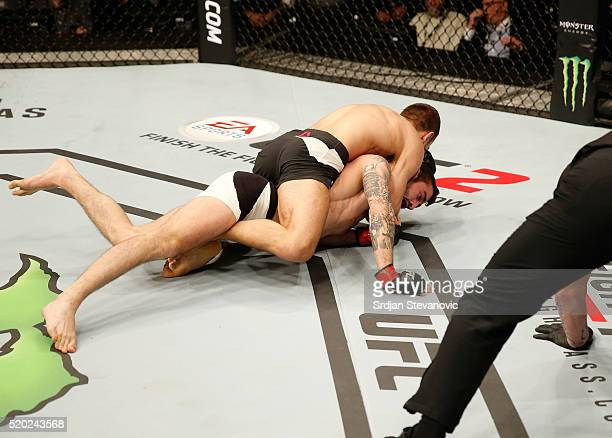 Damian Stasiakin attempts to submit Filip Pejic in their bantamweight bout during the UFC Fight Night event at the Arena Zagreb on April 10 2016 in...
