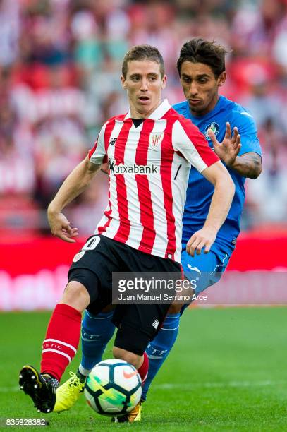 Damian Suarez of Getafe CF competes for the ball with Iker Muniain of Athletic Club during the La Liga match between Athletic Club and Getafe at at...