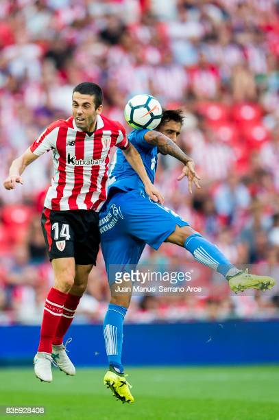 Damian Suarez of Getafe CF competes for the ball with Markel Susaeta of Athletic Club during the La Liga match between Athletic Club and Getafe at at...
