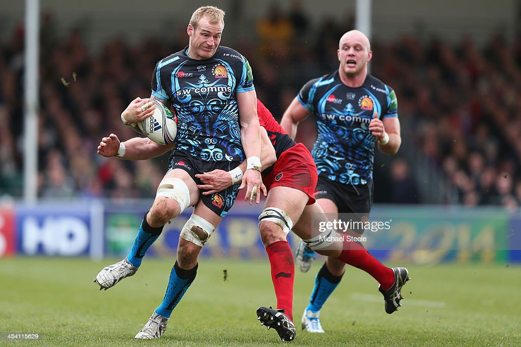Damian Welch (L) of Exeter Chiefs is held up by <a gi-track='captionPersonalityLinkClicked' href=/galleries/search?phrase=Bakkies+Botha&family=editorial&specificpeople=227062 ng-click='$event.stopPropagation()'>Bakkies Botha</a> (R) of Toulon during the Heineken Cup Pool Two match between Exeter Chiefs and Toulon at Sandy Park on December 7, 2013 in Exeter, England.