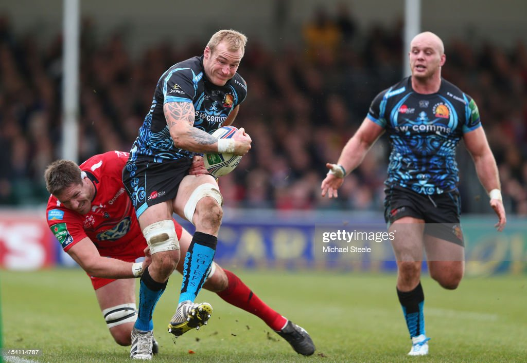 Damian Welch (C) of Exeter Chiefs is tackled by Bakkies Botha (L) of Toulon during the Heineken Cup Pool Two match between Exeter Chiefs and Toulon at Sandy Park on December 7, 2013 in Exeter, England.