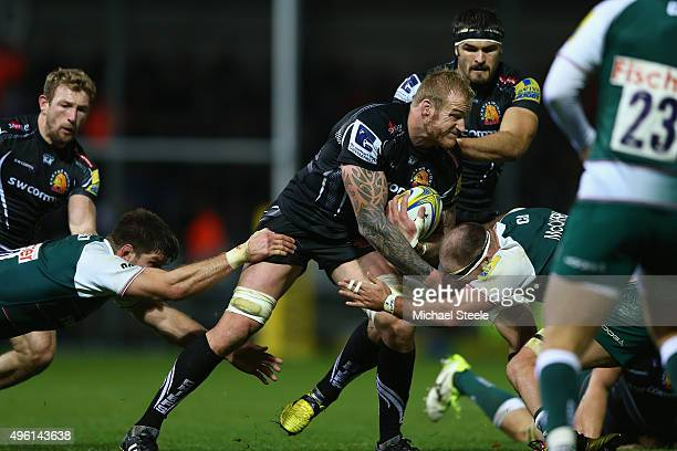Damian Welch of Exeter Chiefs powers his way into Lachlan McCaffrey of Leicester Tigers during the Aviva Premiership match between Exeter Chiefs and...