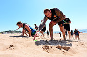 Damian Welch of Exeter Chiefs sprints up a sand dune during a training session on Exmouth Beach on July 19 2016 in Exmouth England