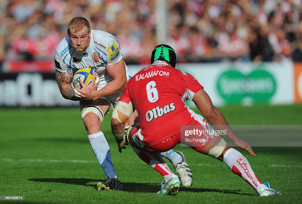 Damian Welch of Exeter races past Sione Kalamafoni of Gloucester during the Aviva Premiership match between Gloucester and Exeter Chiefs at Kingsholm Stadium on October 6, 2013 in Gloucester, England.