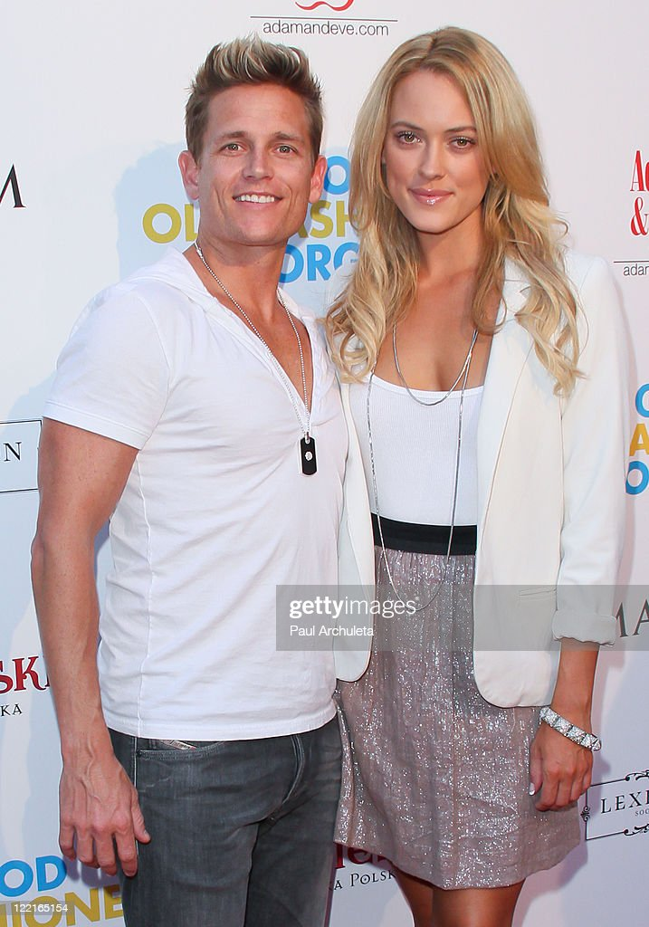 Damian Whitewood (L) and Peta Murgatroyd (R) arrive at the screening for 'A Good Old Fashioned Orgy' on August 25, 2011 in Los Angeles, California.