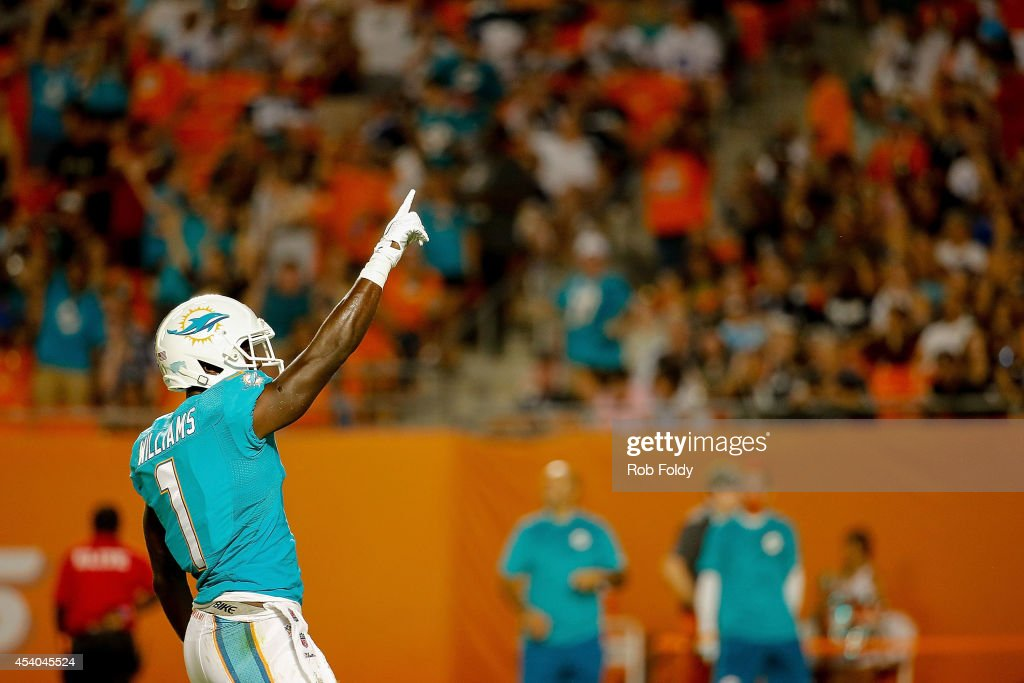 Damian Williams #1 of the Miami Dolphins reacts after a play during the game against the Dallas Cowboys at Sun Life Stadium on August 23, 2014 in Miami Gardens, Florida.