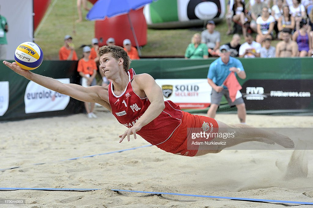 Damian Wojtasik from Poland digs for the ball during the match between Spain and Poland during Day 5 of the FIVB World Championships on July 5, 2013 in Stare Jablonki, Poland.