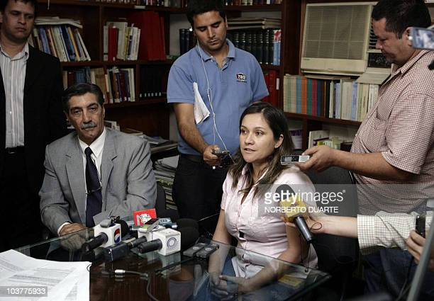 Damiana Hortensia Moran and her attorney Oscar Tuma who filed a paternity lawsuit against Paraguayan President Fernando Lugo speak during a news...