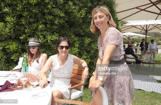 Damiana Leoni and Maria Grazia Chiuri attend the Picnic Swing at 'La Posta Vecchia' on May 30 2010 in Ladispoli Italy