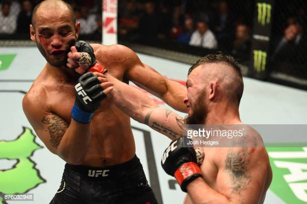 Damien Brown of Austrailia punches Frank Camacho of Guam in their lightweight bout during the UFC Fight Night event inside the Qudos Bank Arena on...