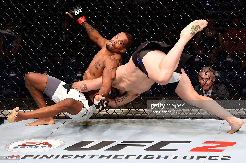 Damien Brown of Australia takes down Alan Patrick of Brazil in their lightweight bout during the UFC Fight Night event at the Brisbane Entertainment...