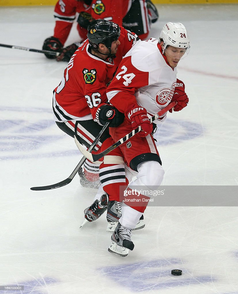 <a gi-track='captionPersonalityLinkClicked' href=/galleries/search?phrase=Damien+Brunner&family=editorial&specificpeople=6931570 ng-click='$event.stopPropagation()'>Damien Brunner</a> #24 of the Detroit Red Wings battles with Dave Bolland #36 of the Chicago Blackhawks in Game One of the Western Conference Semifinals during the 2013 NHL Stanley Cup Playoffs at the United Center on May 15, 2013 in Chicago, Illinois. The Blackhawks defeated the Red Wings 4-1.