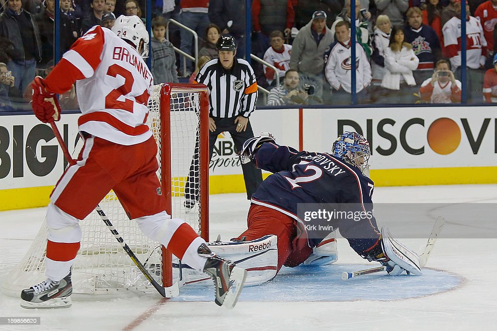 Damien Brunner #24 of the Detroit Red Wings beats <a gi-track='captionPersonalityLinkClicked' href=/galleries/search?phrase=Sergei+Bobrovsky&family=editorial&specificpeople=4488556 ng-click='$event.stopPropagation()'>Sergei Bobrovsky</a> #72 of the Columbus Blue Jackets for the game winning goal during the shootout on January 21, 2013 at Nationwide Arena in Columbus, Ohio. Detroit defeated Columbus 4-3 in a shootout.