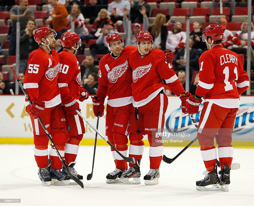 Damien Brunner #24 of the Detroit Red Wings celebrates his third period goal with <a gi-track='captionPersonalityLinkClicked' href=/galleries/search?phrase=Daniel+Cleary&family=editorial&specificpeople=220490 ng-click='$event.stopPropagation()'>Daniel Cleary</a> #11, <a gi-track='captionPersonalityLinkClicked' href=/galleries/search?phrase=Pavel+Datsyuk&family=editorial&specificpeople=202893 ng-click='$event.stopPropagation()'>Pavel Datsyuk</a> #13, <a gi-track='captionPersonalityLinkClicked' href=/galleries/search?phrase=Henrik+Zetterberg&family=editorial&specificpeople=201520 ng-click='$event.stopPropagation()'>Henrik Zetterberg</a> #40 and <a gi-track='captionPersonalityLinkClicked' href=/galleries/search?phrase=Niklas+Kronwall&family=editorial&specificpeople=220826 ng-click='$event.stopPropagation()'>Niklas Kronwall</a> #55 while playing the Dallas Stars at Joe Louis Arena on January 22, 2013 in Detroit, Michigan. Dallas won the game 2-1.