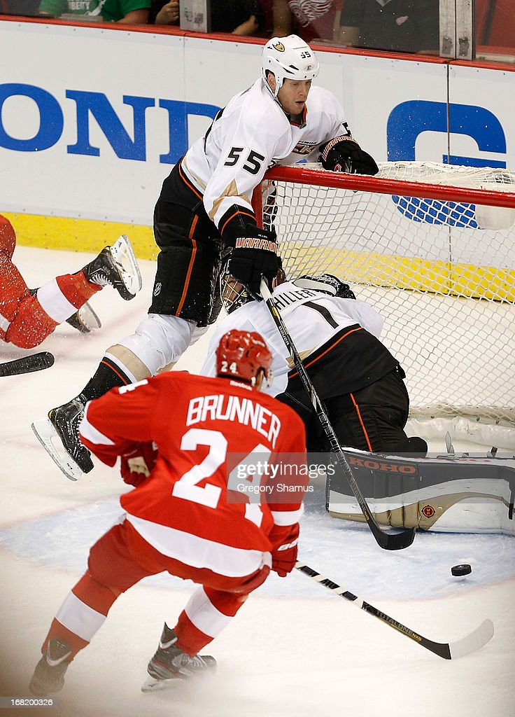 <a gi-track='captionPersonalityLinkClicked' href=/galleries/search?phrase=Damien+Brunner&family=editorial&specificpeople=6931570 ng-click='$event.stopPropagation()'>Damien Brunner</a> #24 of the Detroit Red Wings gets ready to shoot the game-winning overtime goal past <a gi-track='captionPersonalityLinkClicked' href=/galleries/search?phrase=Jonas+Hiller&family=editorial&specificpeople=743364 ng-click='$event.stopPropagation()'>Jonas Hiller</a> #1 and the <a gi-track='captionPersonalityLinkClicked' href=/galleries/search?phrase=Bryan+Allen+-+Ice+Hockey+Player&family=editorial&specificpeople=206454 ng-click='$event.stopPropagation()'>Bryan Allen</a> #55 of the Anaheim Ducks in Game Four of the Western Conference Quarterfinals during the 2013 NHL Stanley Cup Playoffs at Joe Louis Arena on May 6, 2013 in Detroit, Michigan. Detroit won the game 3-2 in overtime to tie the series at 2-2.