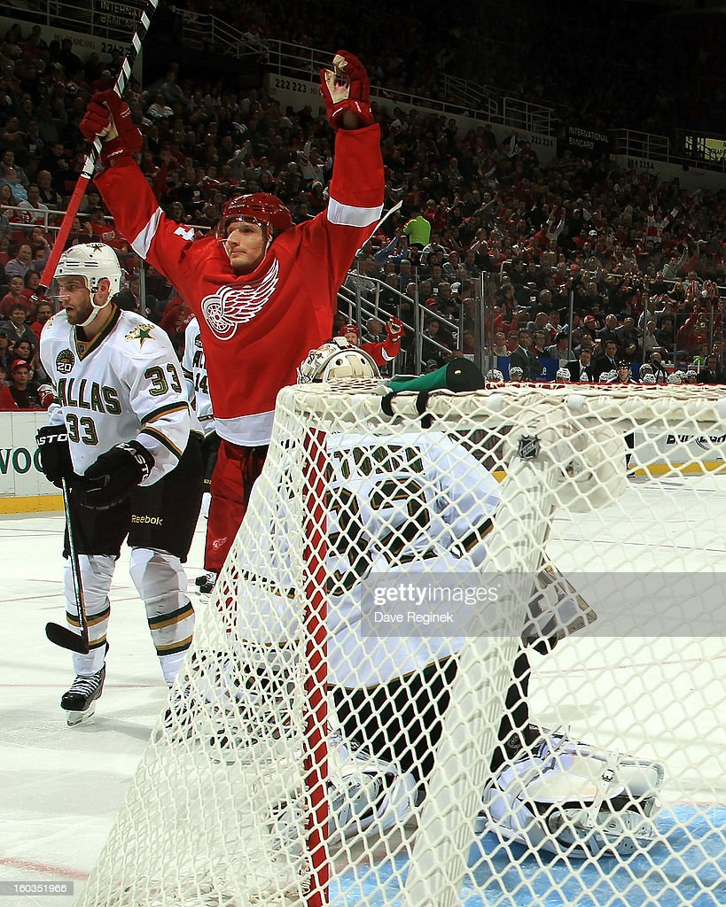 Damien Brunner #24 of the Detroit Red Wings raises his hands after scoring a goal on Kari Lehtonen #32 of the Dallas Stars during an NHL game at Joe Louis Arena on January 29, 2013 in Detroit, Michigan. Detroit defeated Dallas 4-1