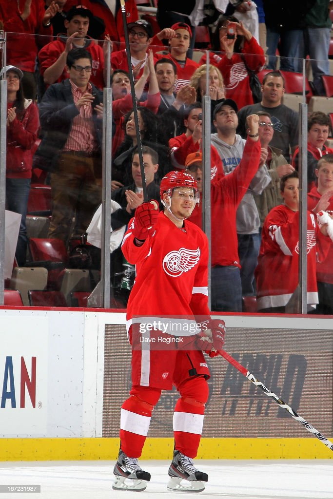 <a gi-track='captionPersonalityLinkClicked' href=/galleries/search?phrase=Damien+Brunner&family=editorial&specificpeople=6931570 ng-click='$event.stopPropagation()'>Damien Brunner</a> #24 of the Detroit Red Wings raises his stick to the crowd after being announced the first star of a NHL game against the Phoenix Coyotes at Joe Louis Arena on April 22, 2013 in Detroit, Michigan. Detroit defeated Phoenix 4-0
