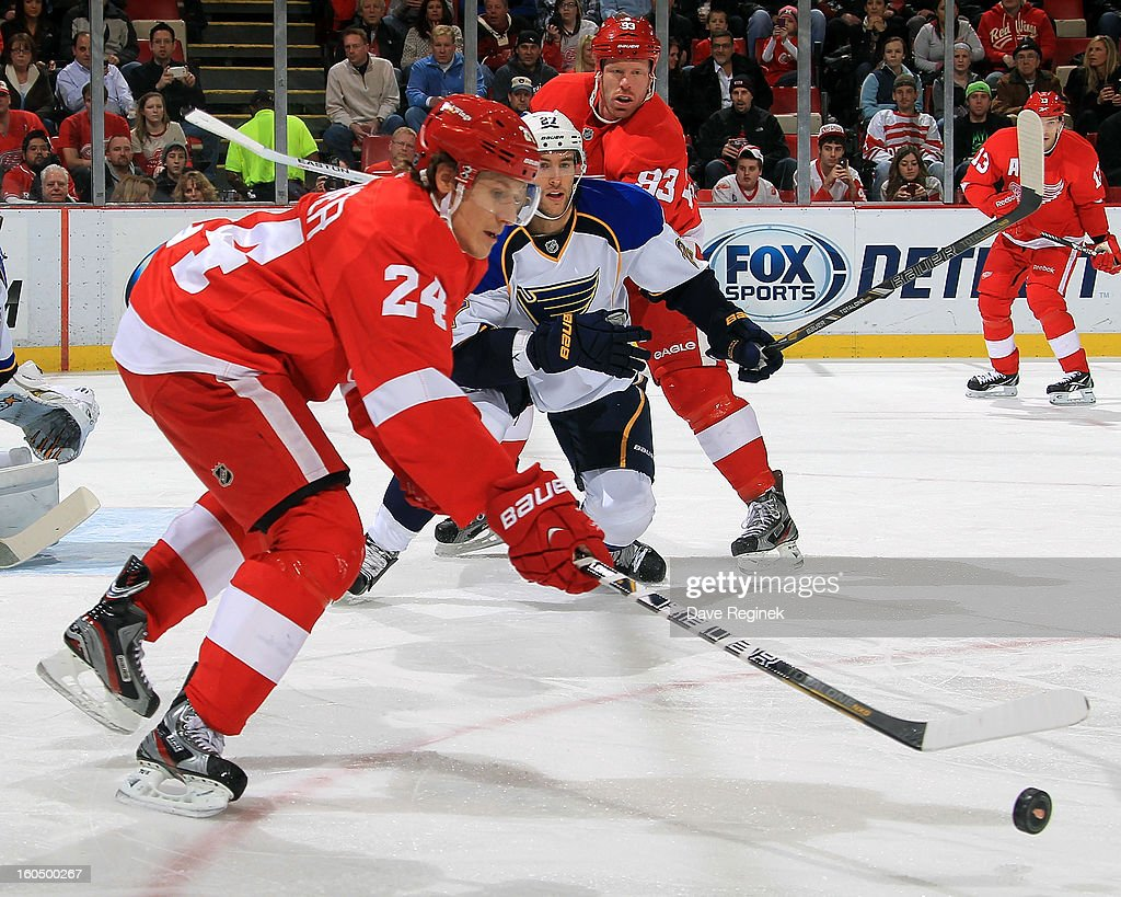 <a gi-track='captionPersonalityLinkClicked' href=/galleries/search?phrase=Damien+Brunner&family=editorial&specificpeople=6931570 ng-click='$event.stopPropagation()'>Damien Brunner</a> #24 of the Detroit Red Wings reaches for the puck as <a gi-track='captionPersonalityLinkClicked' href=/galleries/search?phrase=Alex+Pietrangelo&family=editorial&specificpeople=4072229 ng-click='$event.stopPropagation()'>Alex Pietrangelo</a> #27 of the St Louis Blues defends during a NHL game at Joe Louis Arena on February 1, 2013 in Detroit, Michigan.