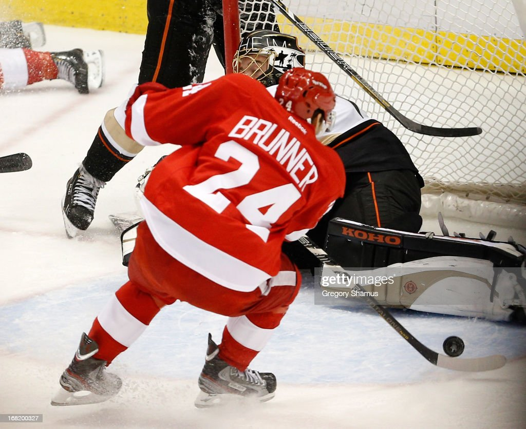 <a gi-track='captionPersonalityLinkClicked' href=/galleries/search?phrase=Damien+Brunner&family=editorial&specificpeople=6931570 ng-click='$event.stopPropagation()'>Damien Brunner</a> #24 of the Detroit Red Wings shoots the game-winning overtime goal past <a gi-track='captionPersonalityLinkClicked' href=/galleries/search?phrase=Jonas+Hiller&family=editorial&specificpeople=743364 ng-click='$event.stopPropagation()'>Jonas Hiller</a> #1 of the Anaheim Ducks in Game Four of the Western Conference Quarterfinals during the 2013 NHL Stanley Cup Playoffs at Joe Louis Arena on May 6, 2013 in Detroit, Michigan. Detroit won the game 3-2 in overtime to tie the series at 2-2.