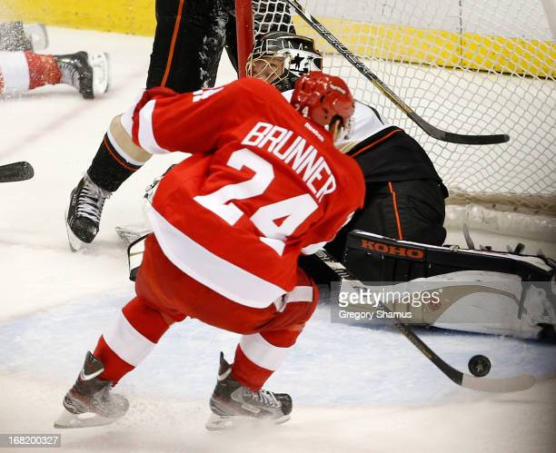 Damien Brunner of the Detroit Red Wings shoots the gamewinning overtime goal past Jonas Hiller of the Anaheim Ducks in Game Four of the Western...