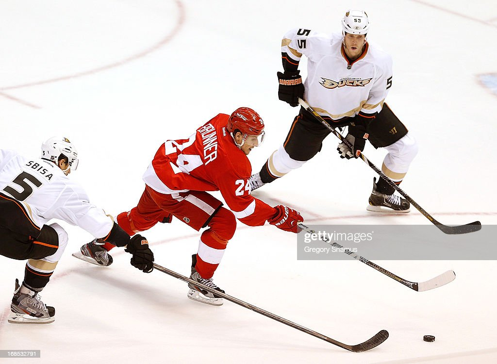 <a gi-track='captionPersonalityLinkClicked' href=/galleries/search?phrase=Damien+Brunner&family=editorial&specificpeople=6931570 ng-click='$event.stopPropagation()'>Damien Brunner</a> #24 of the Detroit Red Wings tries to split the defense of <a gi-track='captionPersonalityLinkClicked' href=/galleries/search?phrase=Bryan+Allen+-+Ice+Hockey+Player&family=editorial&specificpeople=206454 ng-click='$event.stopPropagation()'>Bryan Allen</a> #55 and <a gi-track='captionPersonalityLinkClicked' href=/galleries/search?phrase=Luca+Sbisa&family=editorial&specificpeople=4893043 ng-click='$event.stopPropagation()'>Luca Sbisa</a> #5 of the Anaheim Ducks during the second period in Game Six of the Western Conference Quarterfinals during the 2013 NHL Stanley Cup Playoffs at Joe Louis Arena on May 10, 2013 in Detroit, Michigan.