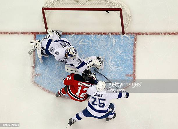 Damien Brunner of the New Jersey Devils puts the puck past Anders Lindback of the Tampa Bay Lightning for the gamewinning goal during the game at the...