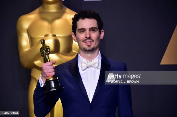 TOPSHOT Damien Chazelle poses in the press room with the Oscar for Best Director during the 89th Annual Academy Awards on February 26 in Hollywood...