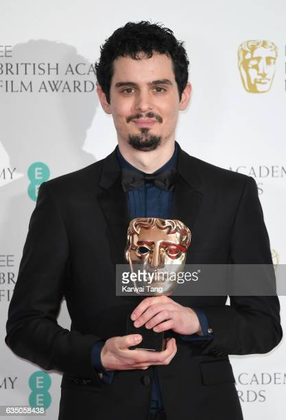 Damien Chazelle winner of Best Director for 'La La Land' poses in the winners room at the 70th EE British Academy Film Awards at the Royal Albert...