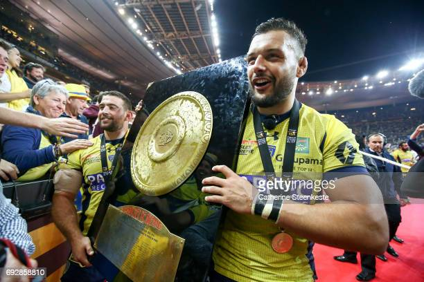 Damien Chouly and Raphael Chaume of ASM Clermont Auvergne show the Bouclier de Brennus trophy to the fans after winning the Top 14 final match...