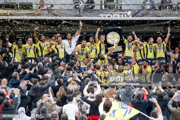Damien Chouly of ASM Clermont Auvergne and his teammates lift the Bouclier de Brennus trophy after winning the Top 14 final match between ASM...
