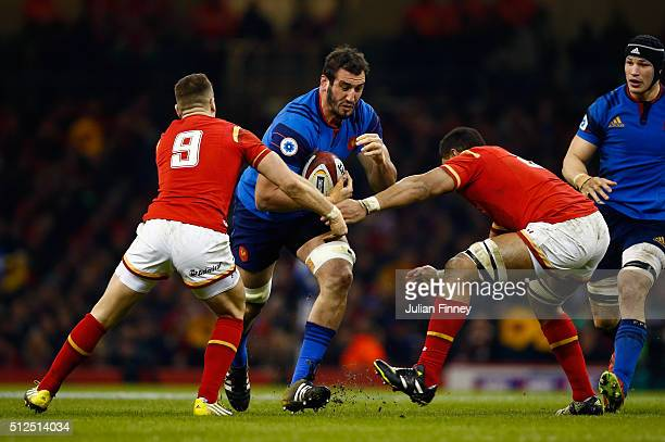Damien Chouly of France is tackled by Gareth Davies and Taulupe Faletau of Wales during the RBS Six Nations match between Wales and France at the...