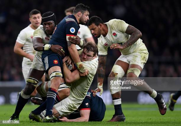 Damien Chouly of France is tackled by Maro Itoje and Joe Launchbury of England during the RBS Six Nations match between England and France at...