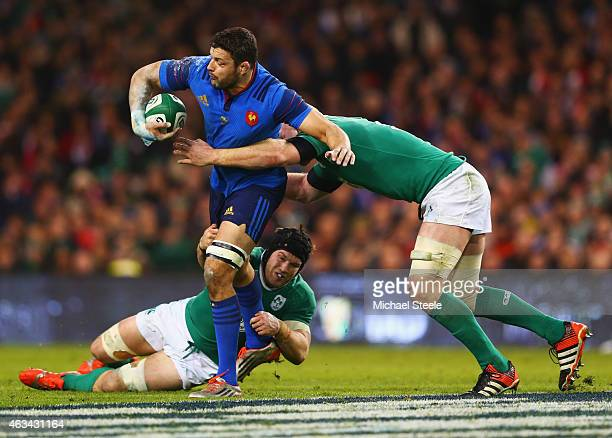 Damien Chouly of France is tackled by Sean O'Brien and Paul O'Connell of Ireland during the RBS Six Nations match between Ireland and France at Aviva...