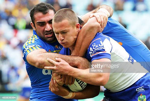 Damien Cook of the Bulldogs is tackled during the round 14 NRL match between the CanterburyBankstown Bulldogs and the Parramatta Eels at ANZ Stadium...
