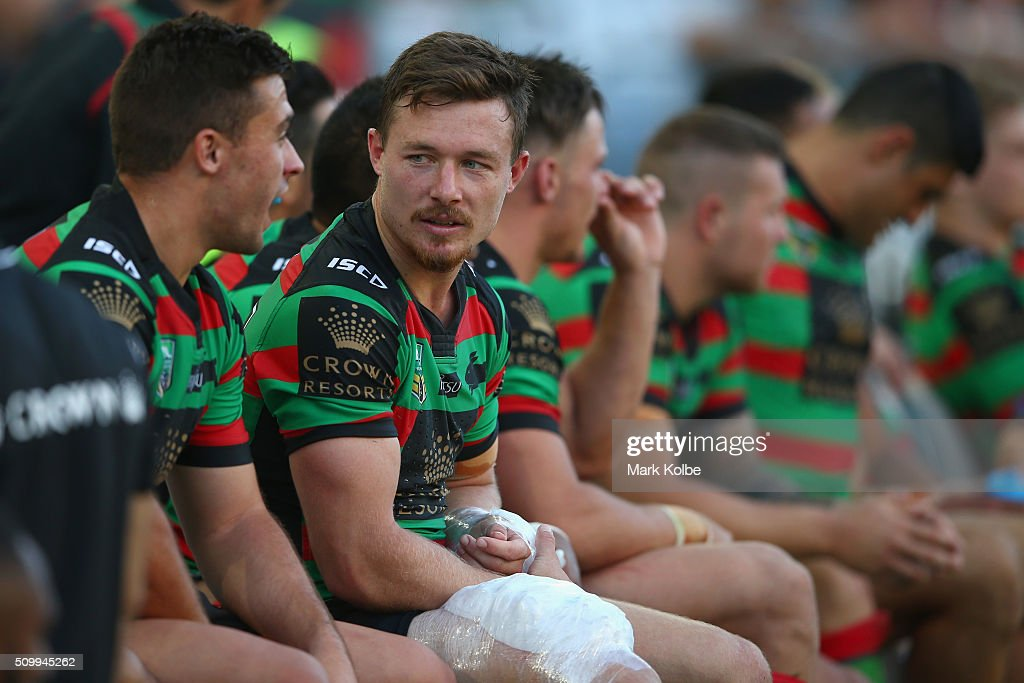 Damien Cook of the Rabbitohs speaks to a team mate as he sits on the bench during the NRL Charity Shield match between the St George Illawarra Dragons and the South Sydney Rabbitohs at ANZ Stadium on February 13, 2016 in Sydney, Australia.