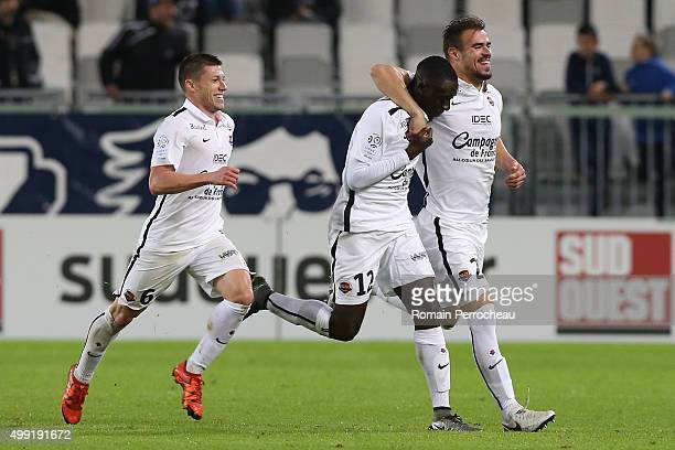Damien Da Silva Dennis Appiah and Jonathan Delaplace for Stade Malherbe de Caen reacts after Damien Da Silva's goal during the French Ligue 1 game...