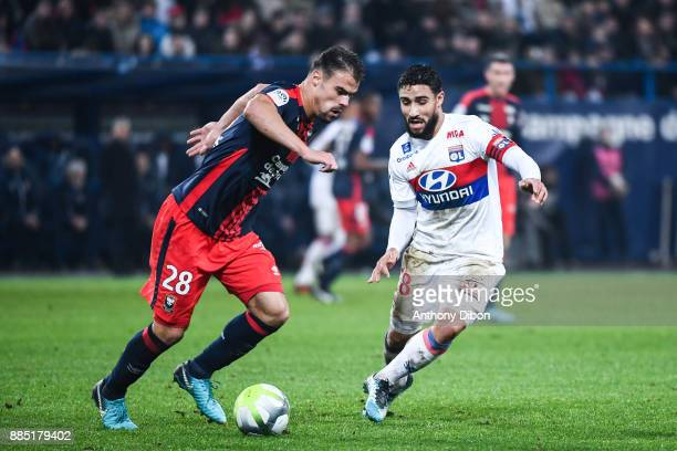 Damien Da Silva of Caen and Nabil Fekir of Lyon during the Ligue 1 match between SM Caen and Olympique Lyonnais at Stade Michel D'Ornano on December...