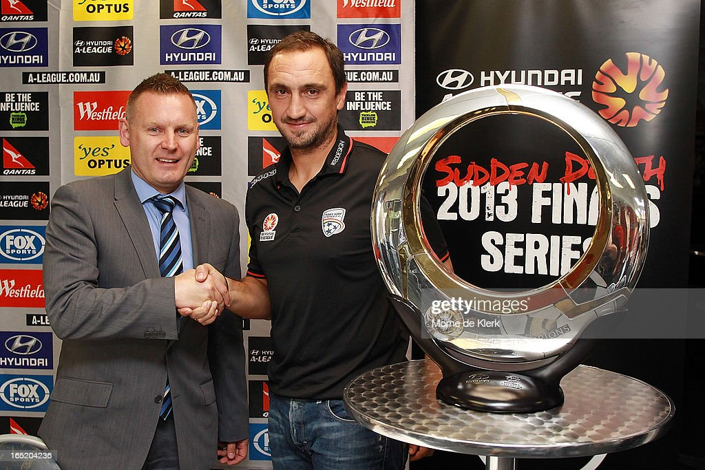 Damien de Bohun, Head of Hyundai A-League and Michael Valkanis, coach of Adelaide pose for a photo during the Adelaide United A-League 2013 Finals Series Launch at Hindmarsh Stadium on April 2, 2013 in Adelaide, Australia.