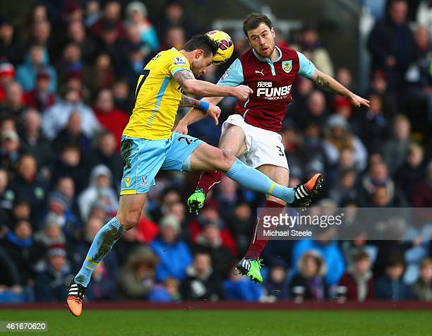 Damien Delaney of Crystal Palace and Ashley Barnes of Burnley battle for the ball during the Barclays Premier League match between Burnley and...