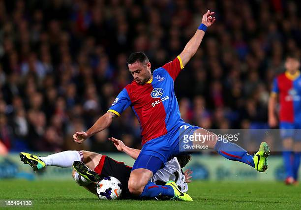 Damien Delaney of Crystal Palace and Scott Parker of Fulham collide during the Barclays Premier League match between Crystal Palace and Fulham at...