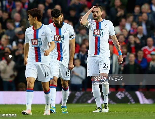 Damien Delaney of Crystal Palace reacts following scoring an own goal during the Barclays Premier League match between Manchester United and Crystal...