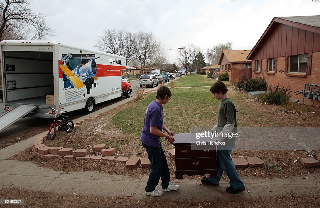 Damien DeNeir (R) helps his grandmother, Kim DeNeir (L) carry dresser to a moving van as they move out of their apartment April 2, 2008 in Arvada, Colorado. The DeNeirs are being forced to move from the rental apartment where they have lived for 20 years, as it was recently condemned by the city for sewer and rodent problems. The owners of the complex are blaming the sub-prime mortgage meltdown for the reduction in maintenance that led to the property being condemned. The Denver metropolitan area has been hard-hit by the housing downturn, with officials estimating that as many as 11,000 properties might go into foreclosure this year.