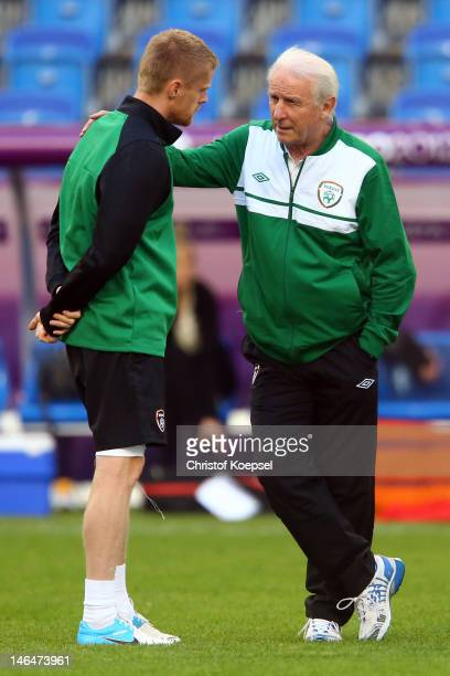 Damien Duff and head coach Giovanni Trapattoni of Ireland talk during a UEFA EURO 2012 training session at the Municipal Stadium on June 17 2012 in...