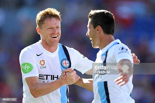 Damien Duff and Robert Koren of Melbourne City celebrate a goal during the round 14 ALeague match between the Newcastle Jets and Melbourne City FC at...
