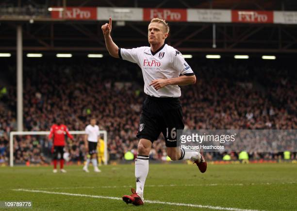Damien Duff of Fulham celebrates scoring the first goal during the Barclays Premier League match between Fulham and Blackburn Rovers at Craven...