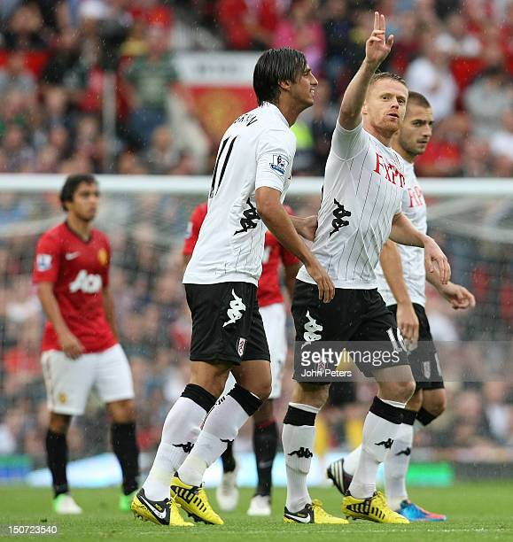 Damien Duff of Fulham celebrates scoring their first goal during the Barclays Premier League match between Manchester United and Fulham at Old...