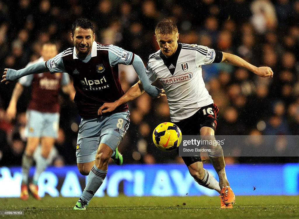 <a gi-track='captionPersonalityLinkClicked' href=/galleries/search?phrase=Damien+Duff&family=editorial&specificpeople=171295 ng-click='$event.stopPropagation()'>Damien Duff</a> of Fulham is challenged by <a gi-track='captionPersonalityLinkClicked' href=/galleries/search?phrase=Razvan+Rat&family=editorial&specificpeople=2147212 ng-click='$event.stopPropagation()'>Razvan Rat</a> (L) of West Ham during the Barclays Premier League match between Fulham and West Ham United at Craven Cottage on January 1, 2014 in London, England.