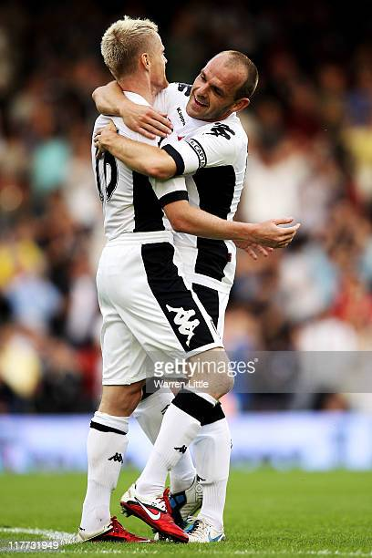 Damien Duff of Fulham is congratulated by teammate Danny Murphy after scoring the opening goal during the UEFA Europa League qualifying match between...